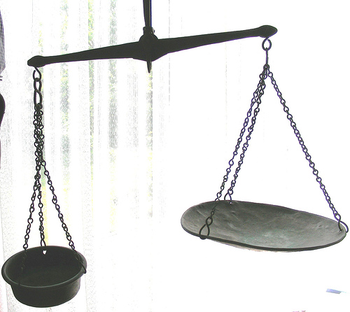 image shows scales to represent justice in this whiplash injury compensation story